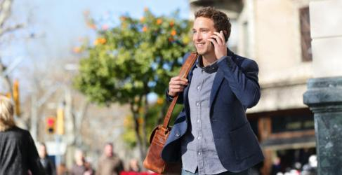business-man-on-smartphone-in-city-620